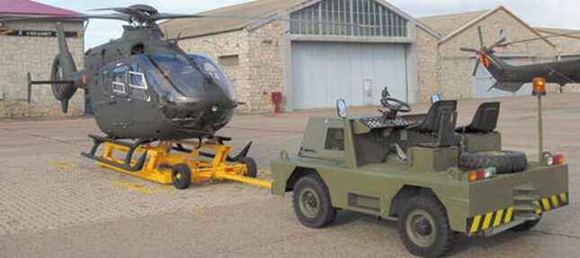 Helicopter lifting and towing devices